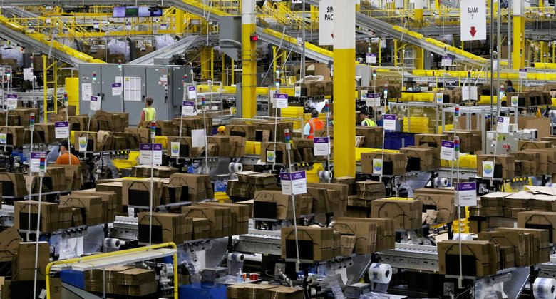 Amazon is being pressed by a group of employee shareholders to disclose more data on the climate impact of its massive logistics and data center operations, such as this fulfillment center in Kent.(Alan Berner / The Seattle Times)