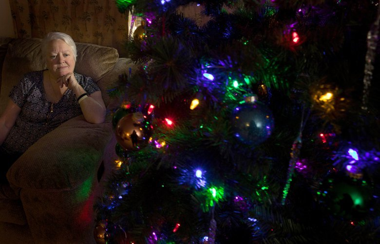 Patricia Cooley her kept her Christmas tree up in the living room since her husband passed away a year ago.  She is leaving it in her living room as she goes through the grieving process of losing her husband of 35 years.  Shot Thursday, December 20, 2018.