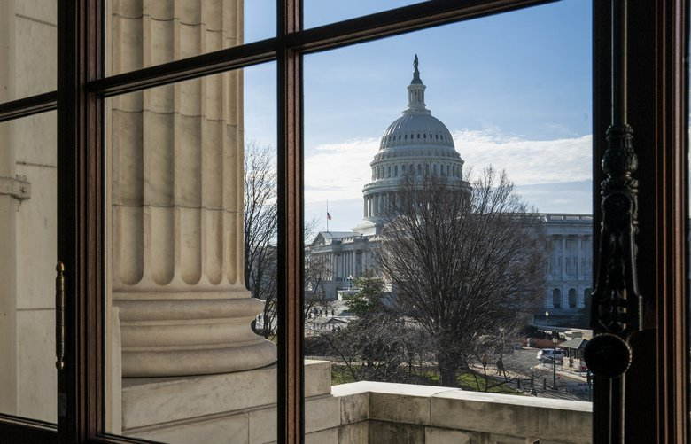 The Capitol Dome is seen from the Russell Senate Office Building in Washington, Thursday, Dec. 27, 2018, during a partial government shutdown.  Chances look slim for ending the partial government shutdown any time soon. Lawmakers are away from Washington for the holidays and have been told they will get 24 hours' notice before having to return for a vote. (AP Photo/J. Scott Applewhite) DCSA106 DCSA106