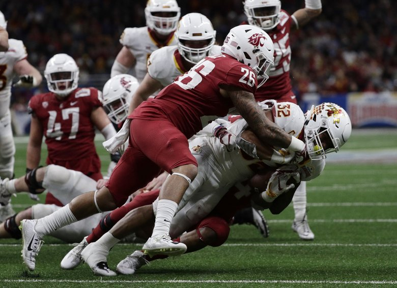 Iowa State running back David Montgomery (32) is hit by Washington State defensive back Hunter Dale (26) and another defender, partially obscure, during the second half of the Alamo Bowl NCAA college football game Friday, Dec. 28, 2018, in San Antonio.  (Eric Gay / The Associated Press)