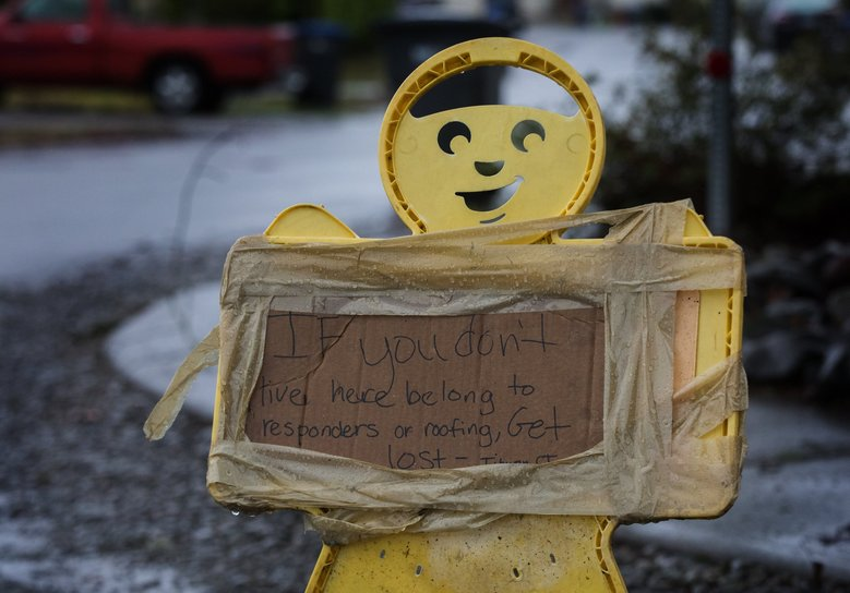 A sign at the entrance to  Southeast Tiburon Court in Port Orchard where a tornado recently touched down. (Ellen M. Banner / The Seattle Times)