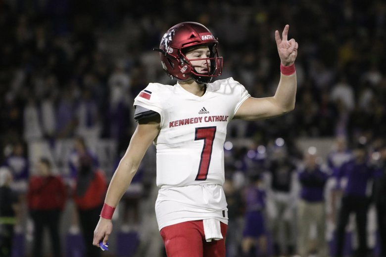 Kennedy Catholic Lancers quarterback Sam Huard signals to the sideline during the first half their Class 4A state preliminary round football game against the Puyallup Vikings at Sparks Stadium on Friday, Nov. 2, 2018 in Puyallup, Wash.   (Jason Redmond / Special to The Seattle Times)