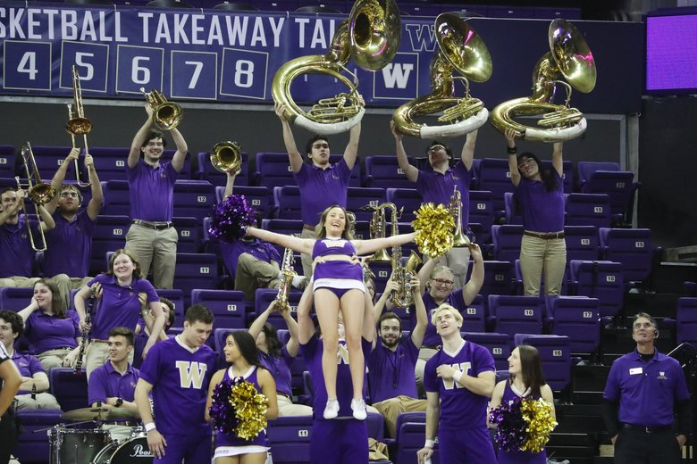 A Washington cheerleader is raised up for the Simba Cam during the Husky Classic championship game, Sunday Dec. 16, 2018, in Seattle.  (Ken Lambert / The Seattle Times)