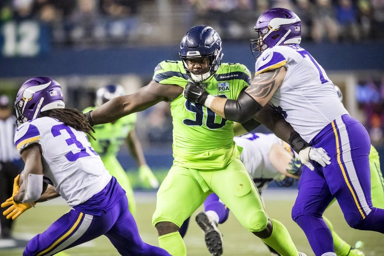 Seahawks defensive tackle Jarran Reed goes after Vikings running back Dalvin Cook in the first half as the Seattle Seahawks take on the Minnesota Vikings for Monday Night Football at CenturyLink Field in Seattle Monday December 10, 2018. 208686 (Bettina Hansen / The Seattle Times)