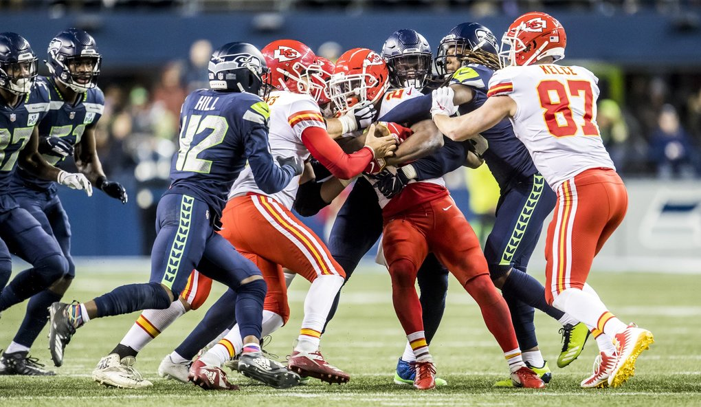 Chiefs running back Damien Williams gets stopped on third down by Seahawks defensive end Frank Clark and cornerback Shaquill Griffin in the second quarter as the Seattle Seahawks take on the Kansas City Chiefs at CenturyLink Field in Seattle Sunday December 23, 2018. (Bettina Hansen / The Seattle Times)