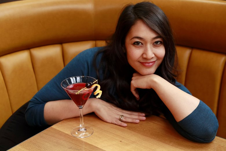 Tantri Wija, photographed at Maslow's by FareStart, is intrigued by our ongoing search for good drinks. And she's willing to continue that quest, for our readers' benefit. (Erika Schultz / The Seattle Times)
