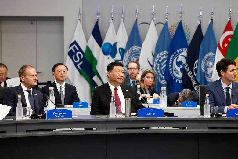 China's President Xi Jinping, center, attends a meeting at the G-20 Leaders' Summit in Buenos Aires, Argentina, on Friday. (Bloomberg photo by Erica Canepa).