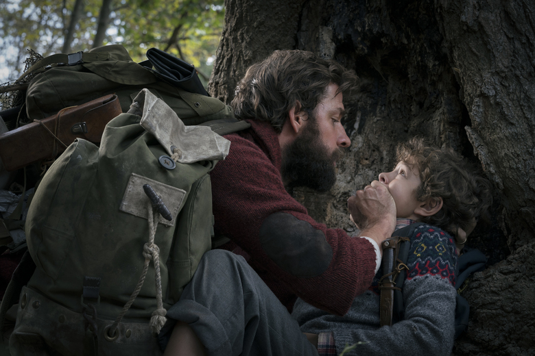 "This image released by Paramount Pictures shows John Krasinski, left, and Noah Jupe in a scene from ""A Quiet Place."" Krasinski's celebrated mostly silent horror sensation ""A Quiet Place"" got only one nomination for Marco Beltrami's score. Krasinski was expected to be a bigger player, for director, screenwriting, and even acting alongside his wife Emily Blunt. (Jonny Cournoyer/Paramount Pictures via AP)"
