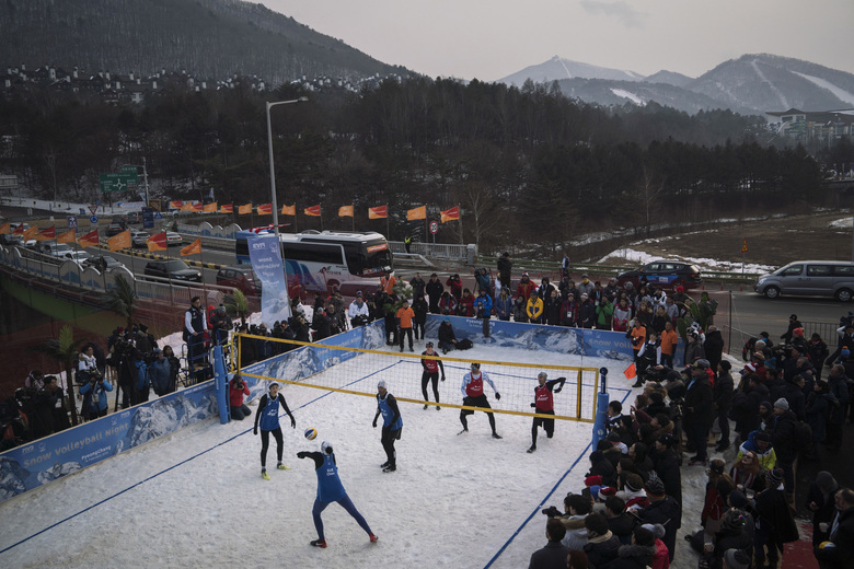 FILE – In this Feb. 14, 2018, file photo, China's Xue Chen passes the ball during a snow volleyball exhibition match at Austria House in Pyeongchang, South Korea. When USA Volleyball asked four-time Olympian Lloy Ball to put together a team for a snow volleyball tournament in Moscow this week, the 2008 gold medalist was eager to accept. Never mind that he's never played on the snow before. (AP Photo/Felipe Dana, File)
