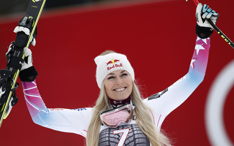 FILE – In this Feb. 4, 2018, file photo, United States' Lindsey Vonn celebrates on the podium after winning an alpine ski, women's world Cup downhill race, in Garmisch Partenkirchen, Germany. Vonn is hoping to return from injury in January 2019 and resume her pursuit of the all-time World Cup wins record, according to the U.S. Ski Team's head coach. Olympic downhill champion Sofia Goggia is also hoping to return from injury in January. (AP Photo/Gabriele Facciotti, File)