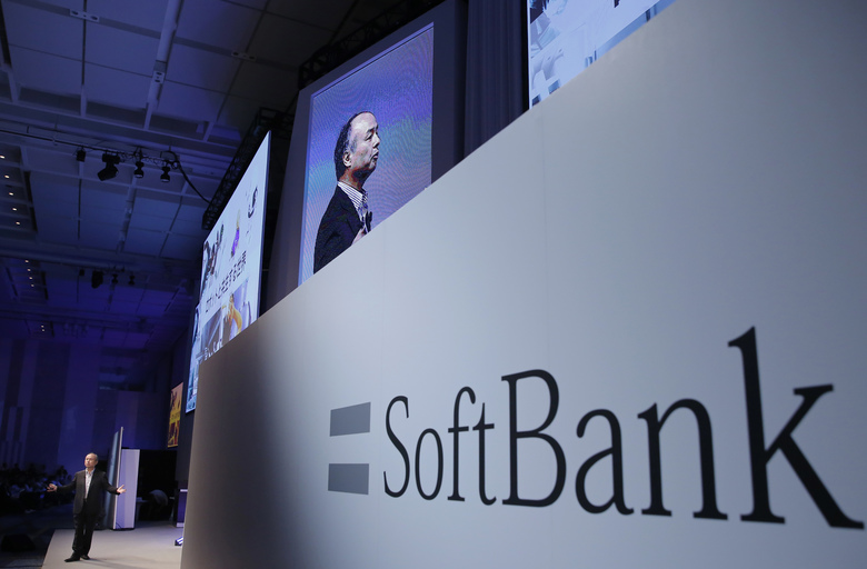 FILE – In this July 20, 2017, file photo, SoftBank Group Corp. Chief Executive Officer Masayoshi Son, left, speaks during a SoftBank World presentation at a hotel in Tokyo. SoftBank Group Corp.'s Japanese mobile subsidiary has gone public in one of the world's biggest share offerings rivaling that of China's Alibaba Group. On Wednesday, Dec. 19, 2018, its IPO on the Tokyo Stock Exchange seeks to raise more than 2 trillion yen ($18 billion). (AP Photo/Shizuo Kambayashi, File)