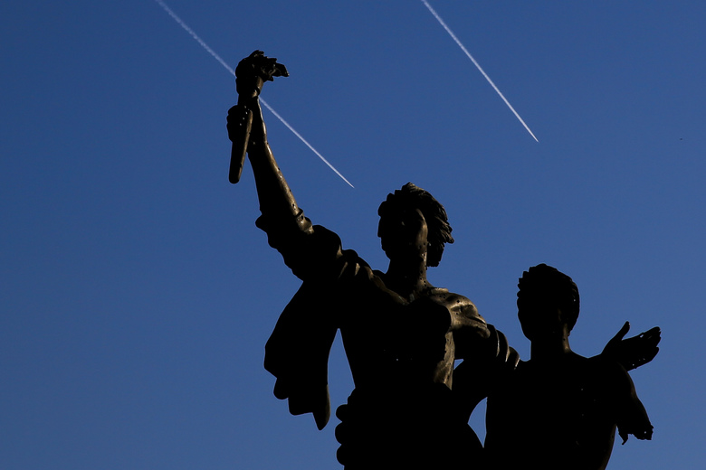Israeli warplanes fly behind the Statue of Martyrs in Martyrs Square in downtown Beirut, Lebanon, Monday, Oct. 29, 2018. (AP Photo/Hassan Ammar)
