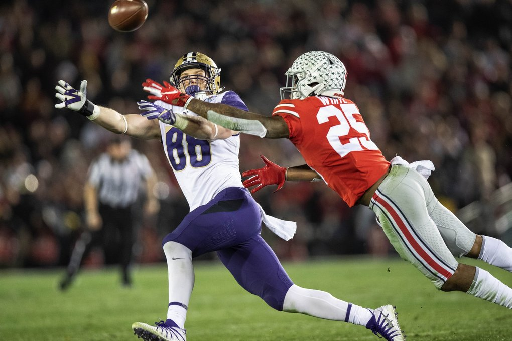 The Huskies push downfield in the 4th quarter.  But this pass to Drew Sample goes off his fingertips, defended by Ohio State's Brendon White. (Dean Rutz / The Seattle Times)