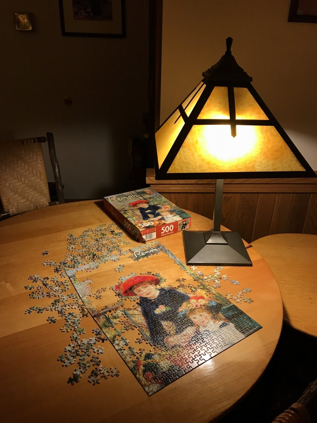 Winter visitors to the National Park Inn at Mount Rainier pass the time sitting before the fire, reading and putting together jigsaw puzzles.  (Carol Pucci / Special to The Seattle Times)