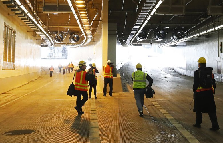 The northbound on-ramp, left, and main traffic south portal, right, are seen during a media tour of the SR 99 tunnel, Thursday, Nov. 15, 2018, in Seattle.