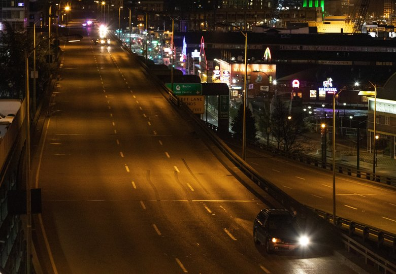 The last car leaves the Alaskan Way Viaduct at 11:40 p.m. after its 10 p.m. closure Friday night, January 11, 2019.  The driver waved while leaving the viaduct for the last time. (Ellen M. Banner / The Seattle Times)