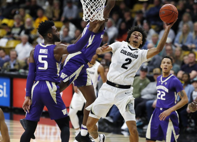 Colorado guard Daylen Kountz (2) shoots as Washington forward Nahziah Carter, second from left, and guard Jaylen Nowell, left, defend during the second half of an NCAA college basketball game Saturday, Jan. 12, 2019, in Boulder, Colo.   (David Zalubowski / The Associated Press)