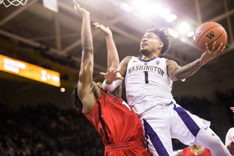 Washington's David Crisp shoots over Seattle U's Myles Carter as the Huskies take on the Redhawks at Alaska Airlines Arena on Sunday, December 9. (Rebekah Welch / The Seattle Times)