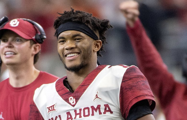 FILE – In this Dec. 1, 2018, file photo, Oklahoma quarterback Kyler Murray (1) celebrates on the sidelines after throwing a touchdown against Oklahoma during the second half of the Big 12 Conference championship NCAA college football game, in Arlington, Texas. Murray was named The Associated Press college football Player of the Year, Thursday, Dec. 6, 2018. (AP Photo/Jeffrey McWhorter, File) NY178