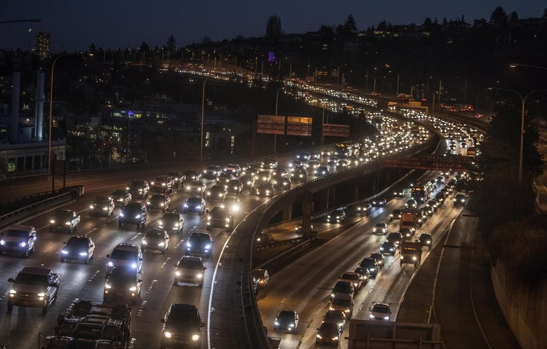 Monday morning was the first weekday commute after the viaduct was closed forever. Southbound on Interstate 5 into Seattle was slow earlier than normal, with stop and go in the express lanes. (Steve Ringman / The Seattle Times)