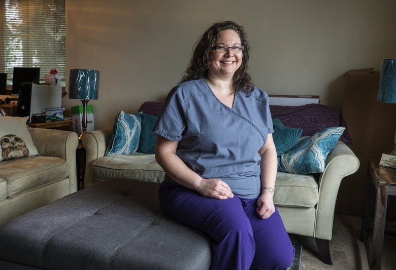 Bridget Smith, a 38-year-old nurse with a son, is working to move up from the paycheck-to-paycheck situation she has found herself in. (Steve Ringman / The Seattle Times)