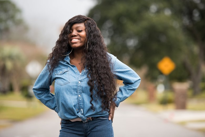 "Carmen Duncan, who has been participating in a gene therapy clinical trial to treat sickle-cell anemia, outside her grandmother's residence, in Charleston, S.C., Nov. 10, 2018. Success in gene therapy against sickle-cell would mark ""the first genetic cure of a common genetic disease"" and could free tens of thousands of Americans from agonizing pain. (Sean Rayford/The New York Times)"