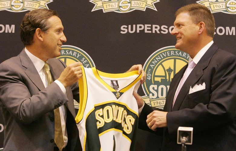 SONICS AND STORM SOLD – SEATTLE – 071806 New Seattle Sonics owner Clayton Bennett, right, is presented a team jersey by former owner Howard Schultz at the conclusion of a news conference on the sale of the Storm and Sonics to an Oklahoma business.