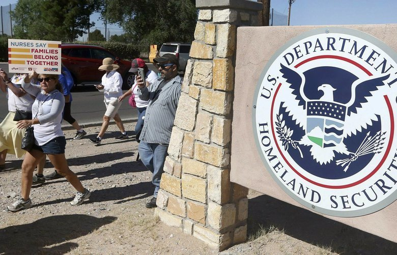 This June 2018 photo shows protesters walking along Montana Avenue outside the El Paso Processing Center, in El Paso, Texas. Federal immigration officials are force feeding some of the immigrants who have been on hunger strike for nearly a month inside the Texas detention facility, The Associated Press has learned. (Rudy Gutierrez/The El Paso Times via AP) TXELP101 TXELP101