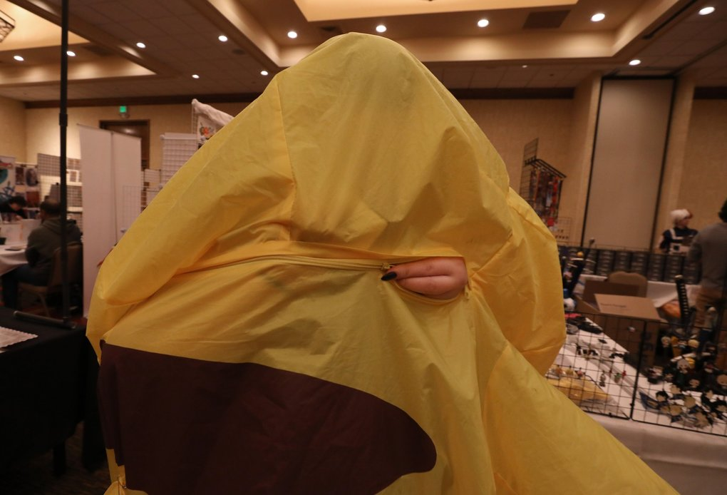 "Why would the designer of the Pikachu anime character costume put the zipper in the back? Meagan Gilbert of Kirkland closes the gap. Inside she says ""it's a little toasty"" at the Aki Con convention in SeaTac on Saturday. (Alan Berner / The Seattle Times)"