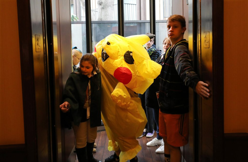 Hold that elevator for one more as Meagan Gilbert in her Pikachu anime costume takes up the center at the Aki Con convention at the SeaTac DoubleTree Hotel. (Alan Berner / The Seattle Times)