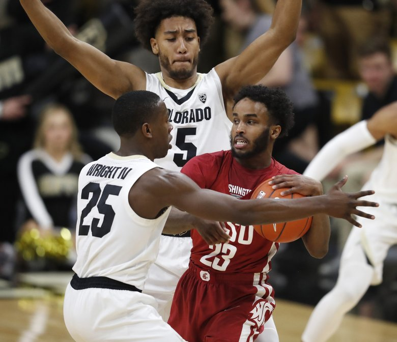 Washington State guard Ahmed Ali, front right, looks to pass the ball as Colorado guard McKinley Wright IV, front left, and guard D'Shawn Schwartz defend during the second half of an NCAA college basketball game Thursday, Jan. 10, 2019, in Boulder, Colo. Colorado won 92-60. (AP Photo/David Zalubowski)