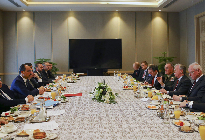 U.S. National Security Adviser John Bolton, 2nd right and his Turkish counterpart and senior adviser to President Recep Tayyip Erdogan, Ibrahim Kalin, left, head their delegations during a meeting at the Presidential Palace in Ankara, Turkey, Tuesday, Jan. 8, 2019.  Bolton has said he is trying to negotiate the safety of Kurdish allies in northeastern Syria in the fight against the Islamic State group. (Presidential Press Service via AP, Pool)