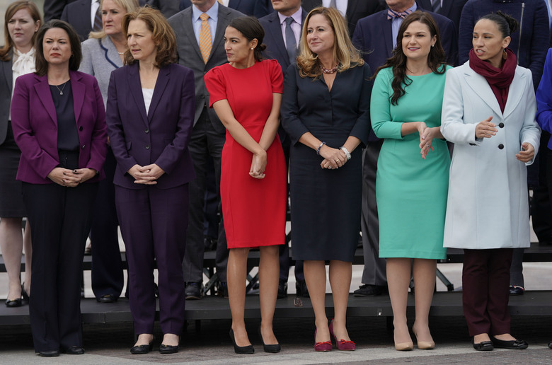 In this Nov. 14, 2018 photo, from l-r., Rep.-elect Angie Craig, D-Minn., Rep.-elect Kim Schrier, D-WA., Rep.-elect Alexandria Ocasio-Cortez, D-NY., Rep.-elect Debbie Mucarsel-Powell, D-Fla., Rep.-elect Abby Finkenauer, D-Iowa, and Rep.-elect Sharice Davids, D-KS., line up as they join other members of the freshman class of Congress for a group photo on Capitol Hill in Washington. (AP Photo/Pablo Martinez Monsivais)