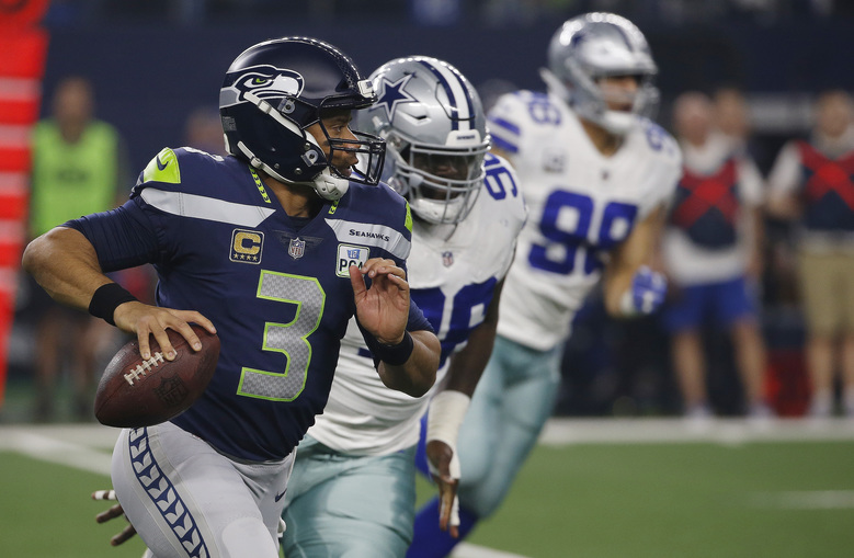 Seattle Seahawks quarterback Russell Wilson (3) runs out of the pocket  against the Dallas 94e5dce87f4ab