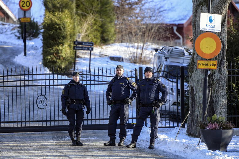 """Security staff are seen at the location where representatives of the United States, North Korea and South Korea are holding a secret meeting, in Stockhom, Sunday, Jan. 20, 2019. President Donald Trump said Saturday that """"things are going very well with North Korea"""" and he plans a second summit with leader Kim Jong Un to try to broker a deal that would entice the North to give up its nuclear weapons. (Anders Wiklund/TT News Agency via AP)"""