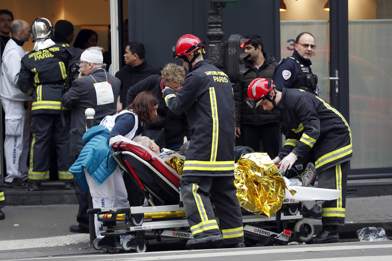 Medical staff and firefighters tend to a wounded man at the scene of a gas leak explosion in Paris, France, Saturday, Jan. 12, 2019. Paris police say several people have been injured in an explosion and fire at a bakery believed caused by a gas leak. (AP Photo/Thibault Camus)