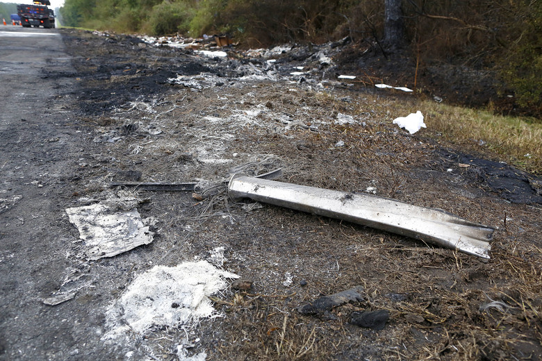 Debris off the south bound side of Interstate 75 remains at the scene of Thursday's multi-vehicle accident that caused multiple fatalities between Alachua and Gainesville, Fla., on Friday, Jan. 4, 2019. (Brad McClenny/The Gainesville Sun via AP)
