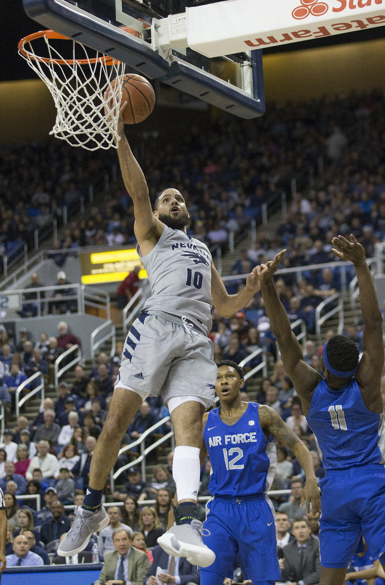 Nevada forward Caleb Martin (10) lays the ball up during the first half against Air Force in an NCAA college basketball game in Reno, Nev., Saturday, Jan. 19, 2019. (AP Photo/Tom R. Smedes)