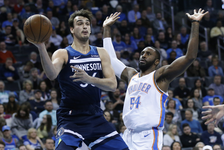 Minnesota Timberwolves forward Dario Saric (36) passes in front of Oklahoma City Thunder forward Patrick Patterson (54) in the first half of an NBA basketball game in Oklahoma City, Tuesday, Jan. 8, 2019. (AP Photo/Sue Ogrocki)