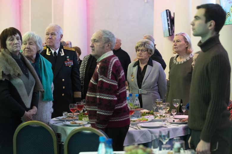 In this Wednesday, Jan. 23, 2019 photo Tamara Chernykh, 81, 3rd right, together with other survivors of the Nazi siege of Leningrad during World War II, observes a moment of silence for its victims during a party marking the 75th anniversary of complete ending of the blockade in St. Petersburg, Russia. The Nazi siege of Leningrad lasted nearly 2 and a half years until the Soviet Army drove the Nazi troops away on Jan. 27, 1944. Estimates of the death toll vary, but historians agree that more than one million Leningrad residents died of hunger and air and artillery bombardment in one of the most horrifying episodes of World War II. (AP Photo/Dmitri Lovetsky)