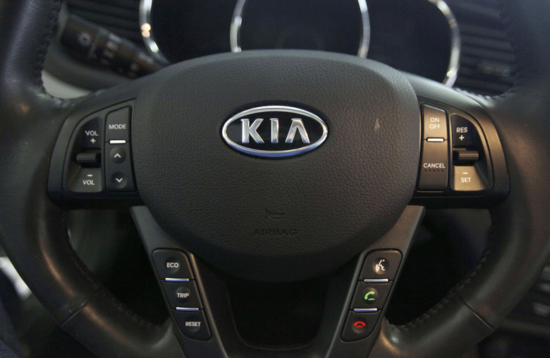 FILE- This Oct. 5, 2012, file photo, shows a Kia optima's steering wheel inside of a Kia car dealership in Elmhurst, Ill. Kia says it will ignore the partial U.S. government shutdown and recall more than 68,000 vehicles to fix a fuel pipe problem that can cause engine fires. The problem stems from previous recall repairs due to engine failures. Kia is only doing the fix on 68,000 of its 618,000 vehicles. 