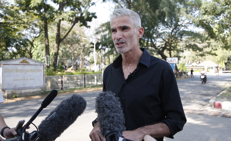 Former Australian soccer national team member Craig Foster talks to journalists after meeting Hakeem al-Araibi, a refugee athlete detained in Thailand, outside a prison in Bangkok, Thailand, Tuesday, Jan. 22, 2019. Foster called on soccer's governing bodies to push for the release of al-Araibi while it weighs an extradition request. (AP Photo/Sakchai Lalit)