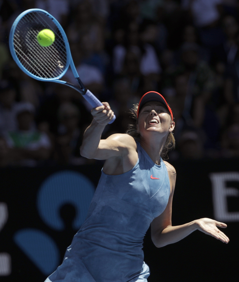 Russia's Maria Sharapova makes a forehand return to Australia's Ashleigh Barty during their fourth round match at the Australian Open tennis championships in Melbourne, Australia, Sunday, Jan. 20, 2019. (AP Photo/Mark Schiefelbein)