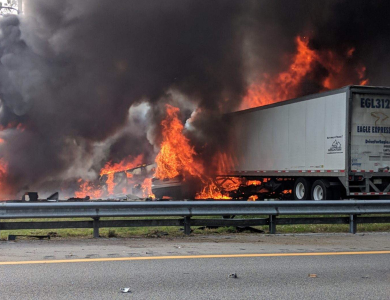 Flames engulf vehicles after a fiery crash along Interstate 75, Thursday, Jan. 3, 2019, about a mile south of Alachua, near Gainesville, Fla. Highway officials say at least six people have died after a crash and diesel fuel spill sparked a massive fire along the Florida interstate. (WGFL-Gainesville via AP)