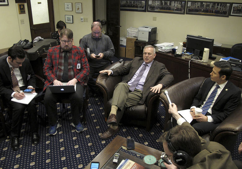 Democratic Alaska state Reps. Bryce Edgmon, second from right, and Neal Foster, right, speak to reporters after Foster was elected temporary speaker of the House, Thursday, Jan. 17, 2019, in Juneau, Alaska. The House has yet to organize a majority and elect a permanent speaker. (AP Photo/Becky Bohrer)