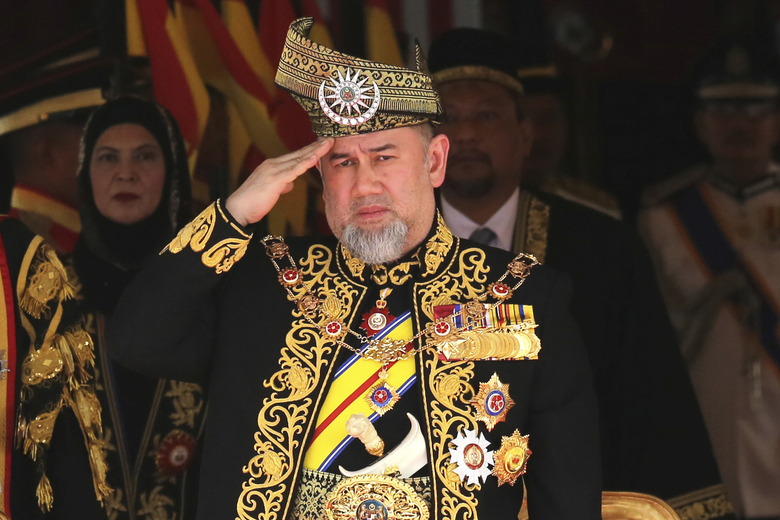 FILE – In this July 17, 2018, file photo, Malaysian King Sultan Muhammad V salutes during the national anthem at the opening of the 14th parliament session at the Parliament house in Kuala Lumpur, Malaysia. The central Malaysian state of Pahang is getting a new sultan who is tipped to become the country's next king under a unique rotating monarchy system. The Conference of Rulers has said it will pick a new king among nine hereditary state rulers on Jan. 24 following the sudden abdication of Sultan Muhammad V. No reasons were given for the Jan. 6 abdication, which came after Sultan Muhammad V reportedly married a former Russian beauty queen. (AP Photo/Yam G-Jun, File)