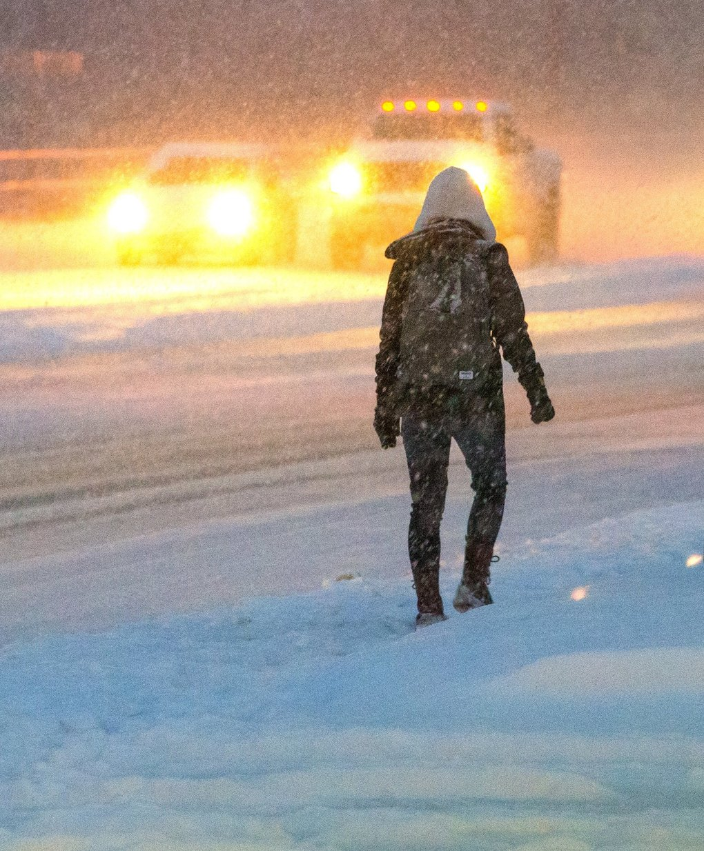 Walking along Northeast Bothell Way in Kenmore was a challenge early Monday, but it may have been more efficient than driving on slick roads. (Mike Siegel / The Seattle Times)