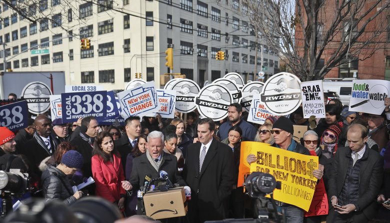Opposition to the Amazon's plan to build a campus in Queens has intensified since the deal was announced in November. Shown here are protesters in November in New York. (Bebeto Matthews / AP)