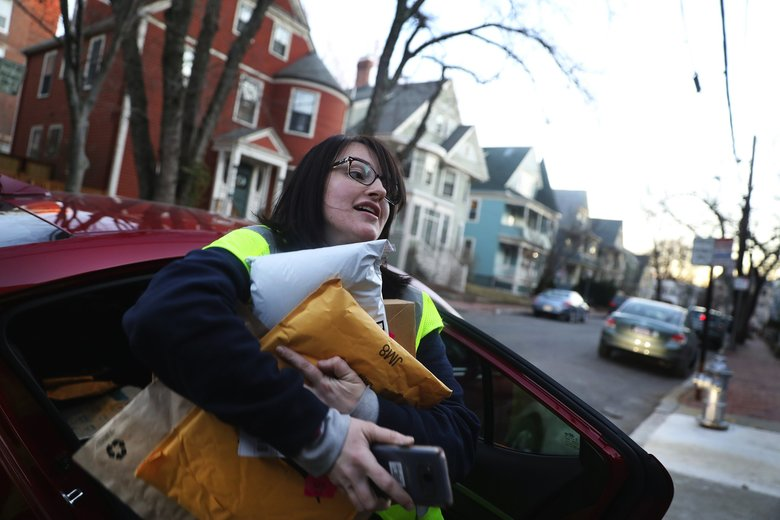 Amazon Flex driver Arielle McCain delivers packages in Cambridge, Massachusetts. Amazon shifted to lightweight plastic mailers in the past year as part of a larger effort to reduce packaging waste and operational costs. But the plastic mailers create recycling challenges. (Pat Greenhouse / Boston Globe)