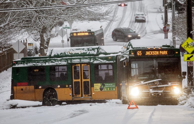 Monday, Feb. 4, 2019.  A Metro bus is jackknifed as it tried to go up NE 55th Street on the slick road with compressed snow.   209226 209226